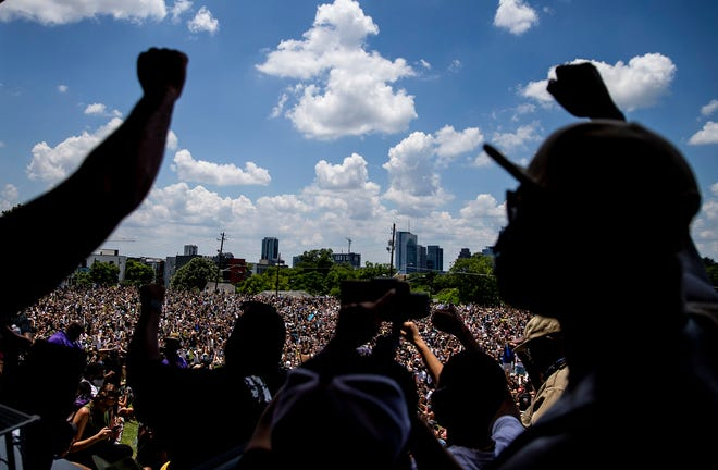 Thousands of Black Lives Matter protesters are shown in June 2020 marching peacefully from Huston-Tillotson University to the state Capitol.