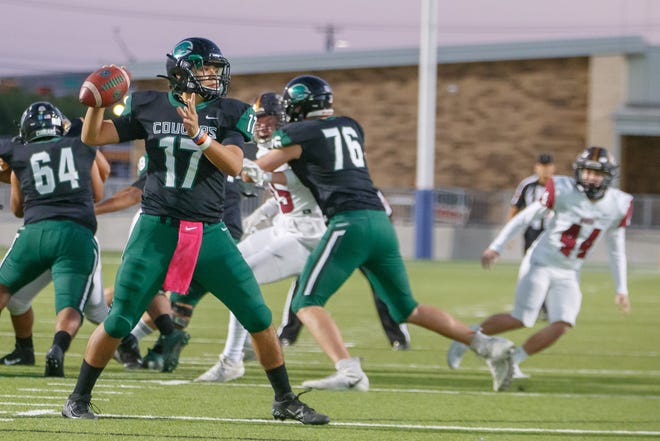 Connally quarterback Justin Santos throws a pass against Rouse during a game last season. Santos returns as the Cougar starter for a second year.