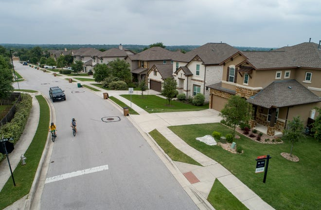 A home is listed for sale on Orba Drive in the Avaña subdivision in Austin's Circle C neighbhordood. Housing prices continue to soar in the Austin metro area.