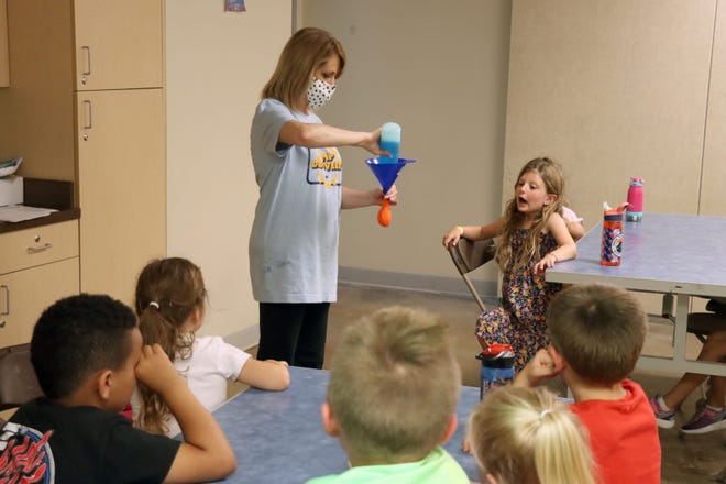 Wendy Rowley prepares an oil versus soap experiment for first graders as part of oceanography lessons during the first day of summer camp at Don Harrington Discovery Center Monday afternoon.
