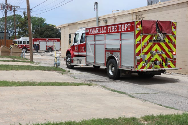 Fire crews respond to a small fire at the back of the old Hastings building located at 4301 SW 45th Ave. early Monday afternoon.