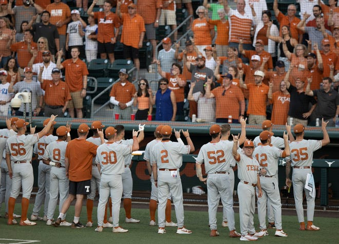 The Texas baseball team sings The Eyes of Texas before the game against Fairfield in the NCAA college baseball regional tournament at Disch-Falk Field on Sunday on June 6, 2021.