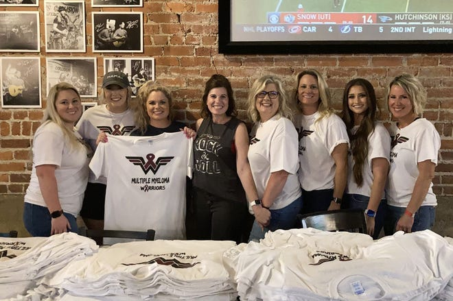 """Julie Phillips, center in black shirt, gathers with friends during the """"Jammin' for Julie"""" mini festival on Saturday, June 5 at Mill Street Tavern. All ticket sales from the event went to Phillips, who was recently diagnosed with multiple myeloma."""