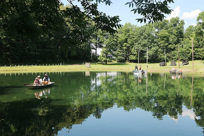 Participants fish Sunday during the Passport To Fishing program at the Jeromesville Coon Hunters pond.