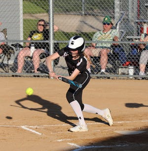 Roland-Story's Reagan Faber goes for a bunt during the Norse's 2-1 victory over Saydel Friday at Roland.