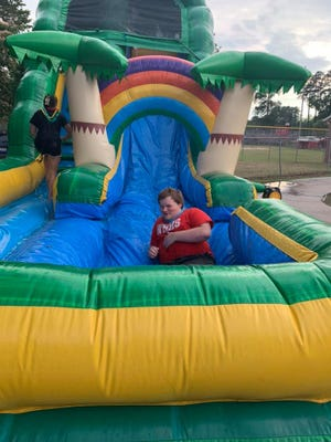 Wade Hampton High School hosted a Senior Sunset on the school's football field on Friday evening, an event which included a water slide and other fun activities for the senior Class of 2021.