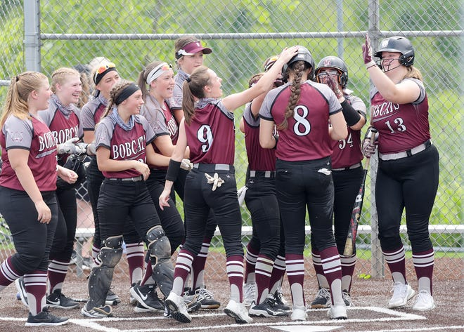 The Beaver Bobcats greet Payton List at home plate after she hit a home run in the second inning during a PIAA Class 4A playoff game against Eastern York, Monday at Norwin High School.[Sally Maxson/For BCT]