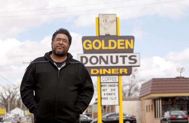 Author Scott Woods near the Golden Donuts Diner in Southfield