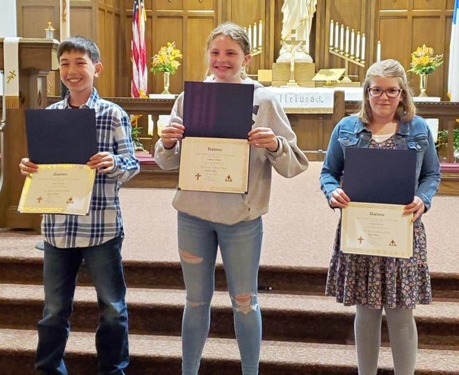 Sixth graders graduating from Our Saviors include Ethan Lanctot, Madilyn Abrams, and Kaitlin DeBoer