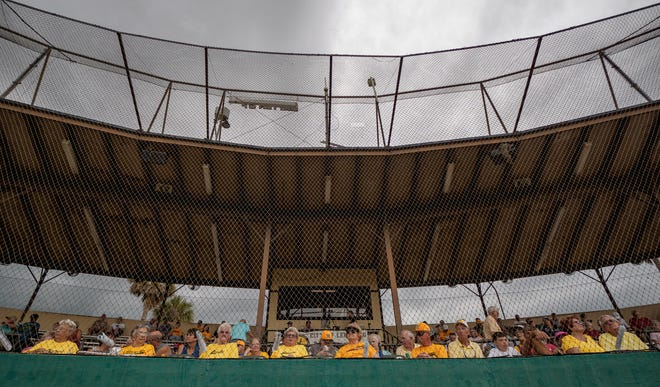 Leesburg Lightning fans wait out weather delay during Saturday's home opener against Winter Garden at Pat Thomas Stadium-Buddy Lowe Field. The game was called and rescheduled for Wednesday after a delay of nearly 90 minutes, due to lightning.[PAUL RYAN / CORRESPONDENT]