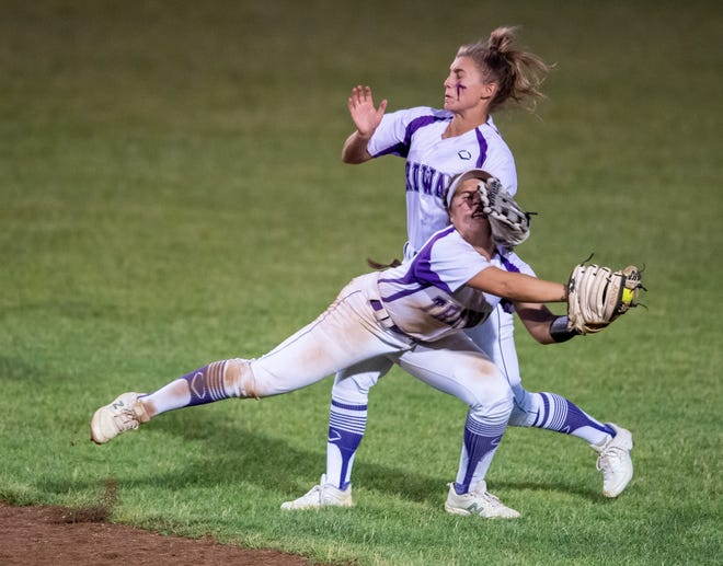 Triway's Hailey Massaro makes a catch in the seventh inning, despite colliding with teammate Emily Yacapraro. Massaro nearly completed what would have been a miraculous double play, but her throw arrived home just late.