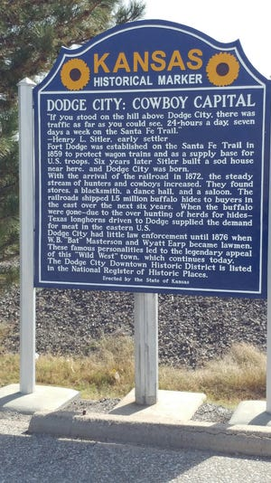 The Kansas historical sign about Dodge City is located on Highway 50 across from the Dodge House Hotel.