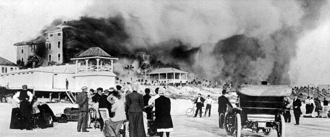 Crowds gather on the beach to watch the Clarendon Hotel Fire, Feb. 14, 1909. This was on the site of the present-day Plaza Resort & Spa.
