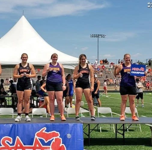 Quincy saw two throwers take a spot on the podium in the Discus. Pictured are Quincy's Sophia Snellenberger (second from right, 2nd place) and Raigen Horsfall (first on right, 4th) on the podium at the D3 state finals