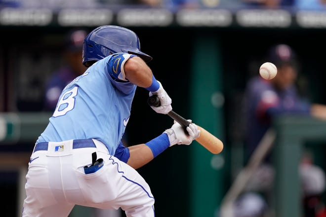 Kansas City Royals' Nicky Lopez bunts into a triple play during the third inning of a baseball game against the Minnesota Twins Sunday at Kauffman Stadium. The Royals had runners on first and second with no outs but the triple play thwarted that threat and the Royals lost 2-1.