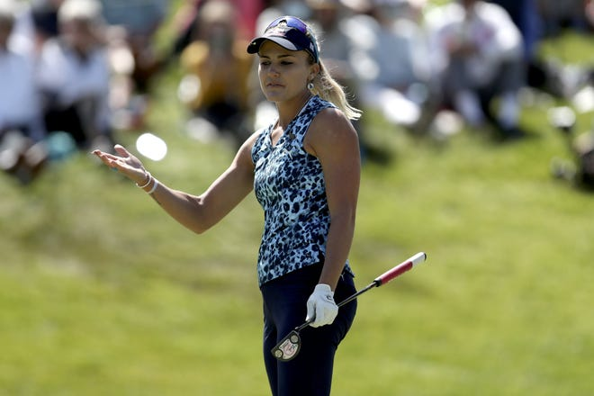 Lexi Thompson reacts after her par putt at the 18th hole comes up short and eliminates her from getting into a playoff for the U.S. Women's Open golf title Sunday at the Olympic Club in San Francisco.