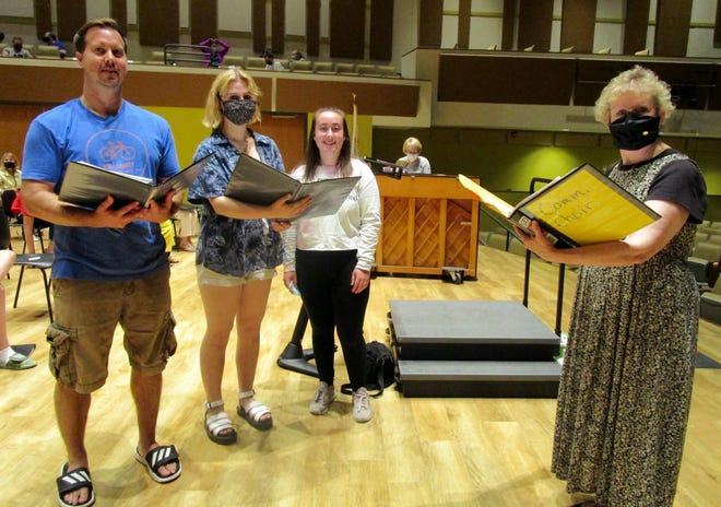 Soloists in this year's Community Choir of Geneseo, from left, Eric Durian, Jaime Bizarri and Hannah Wiyric, rehearse with director Pam Edwards for their June 19 concert in Geneseo City Park.