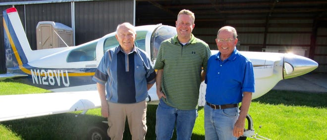 Tony Simon, left; Scott Durian and Todd Sieben are shown by their 1991 American General Tiger plane which will be on display at the annual Father's Day Fly-In / Drive-In Breakfast at Gen-Air Park on Sunday, June 20. Serving will be from 7 to 11 a.m. and Gen-Air Park is located two miles east of Geneseo. Tickets are $7 for adults and $4 for children. For more information, call 309-912-0437 or 309-489-672.