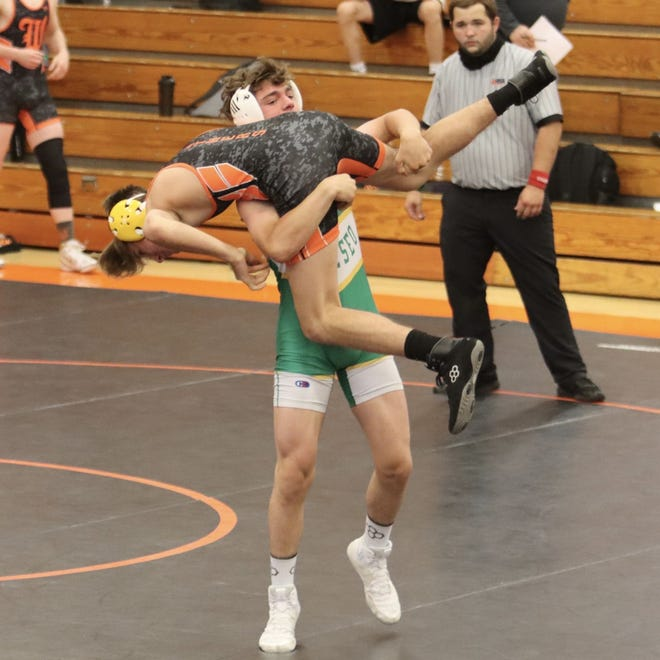 Geneseo's Josh Hock, a freshman, wrestles against Ethan Chadwick from Washington at the 145-lb. weight class in the triangular meet with Washington and East Peoria. Hock won by a fall in 0:11.