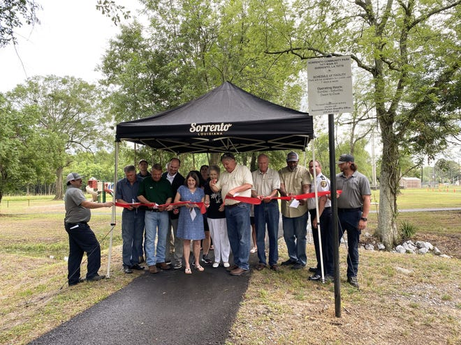 Town of Sorrento dignitaries celebrate a ribbon-cutting ceremony for the new community park.