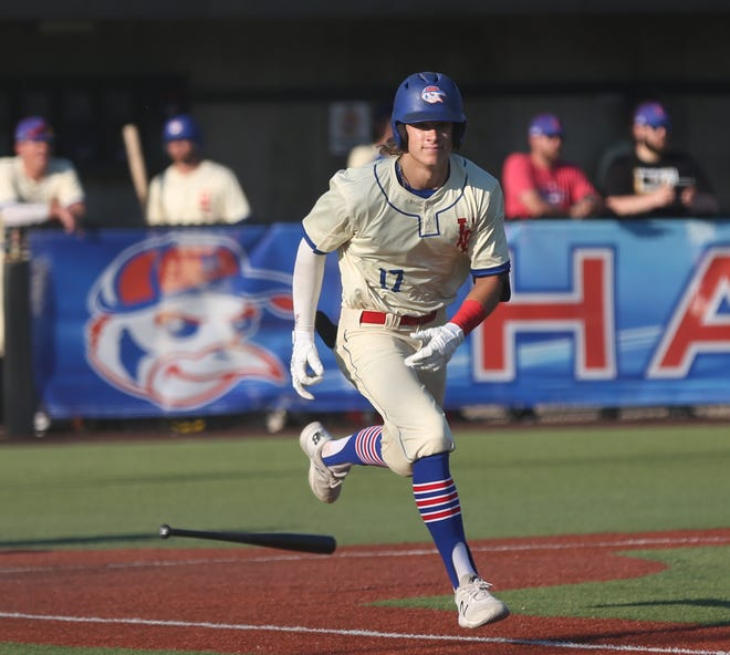 Cameron Pehrson heads to first base after getting a hit in the Hays Larks' season opener against the Colorado Roughnecks. The Larks swept the three-game set.