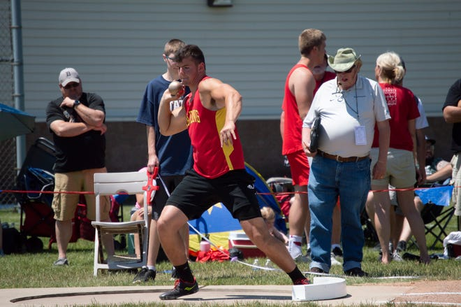Reading's Brogan Wiler throws in the LP D4 Shot put state finals.