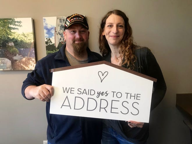 Dan and Addie Conner pose for a photo after closing on their new home. The couple was aided in the purchasing process by local realtor, Jennifer Gradnigo.