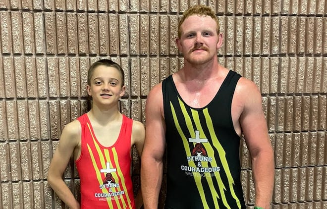 Strong and Courageous Club wrestlers Logan McMinn, left, and Triston Norris pose after competing in the NUWAY Nationals over the weekend in Chattanooga, Tenn.