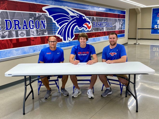 Little River's Jayden Garrison (center) signs his national letter of intent alongside new Blue Dragons head basketball coach Tommy DeSalme (left) and assistant coach Eric Nitsche at the Hutchinson Sports Arena.