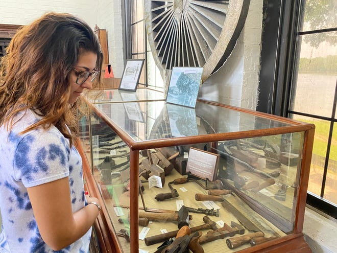 Taylor Heath looks at some of the artifacts in Washington's Western Lands Museum.