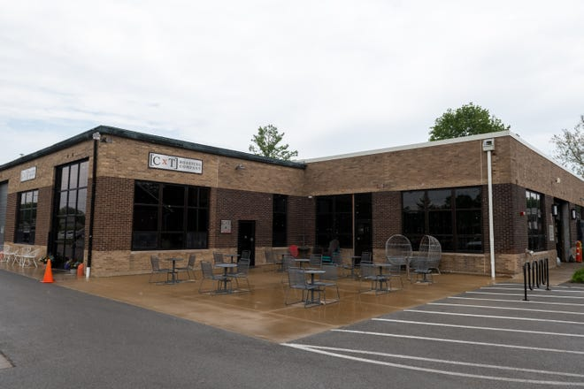 Rain falls on Keller Station on June 7. The building is going through an extensive remodel to make space for more businesses, and is set to open in August.