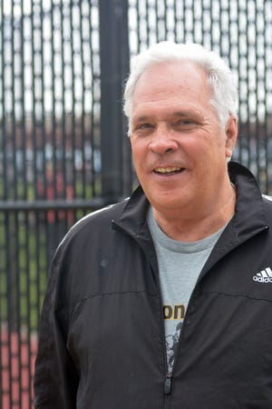 Former Newton High School tennis coach Grant Scott was recently inducted into the Kansas Tennis Coaches Association Hall of Fame.