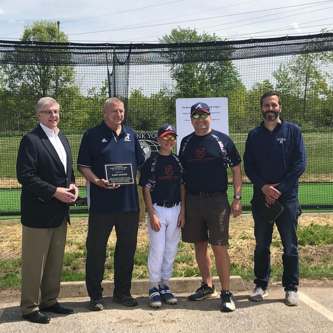 Mayor Craig Shubert, Gary Gough, Charlie Lawrence, Chris Lawrence, and Dave Skoczen at the dedication of a new batting cage on Saturday, May 15. The batting cage is available for all local baseball and softball players. The dedication took place at the the first annual Gary Gough Classic, a mid-season tournament weekend for all in the AA-League, AAA-League, Majors and Koufax League, which includes every player age seven through fourteen in Hudson Kiwanis Baseball.  Thirty-four teams comprised of 410 players participated in a total of 47 games.