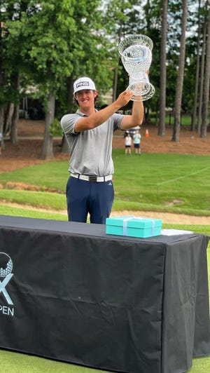 """Former Texas Tech golfer Guillermo """"Mito"""" Pereira holds aloft the crystal trophy after winning the REX Hospital Open on Sunday in Raleigh, North Carolina. Pereira clinched a PGA Tour card with the victory in the Korn Ferry Tour event."""