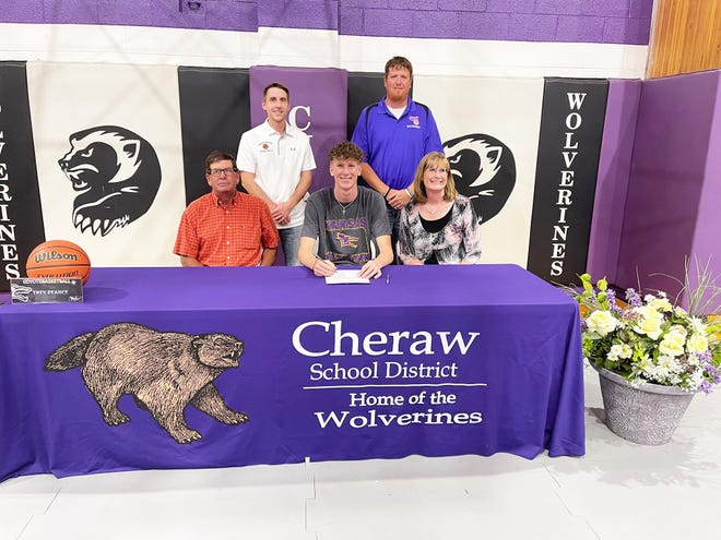 Cheraw High School graduate Trey Pearce (front row center) recently signed a national letter of intent to attend and play men's basketball at Kansas Wesleyan University. Back row, from left, assistant coach Andrew Froese and head coach Colin Leake. Front row, from left, Pearce's father, Ron, Pearce, and Pearce's mother. Caryl.