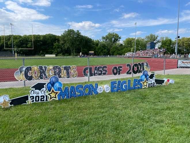 Congratulatory signs welcome Erie Mason's graduating seniors to Sunday's commencement ceremony.