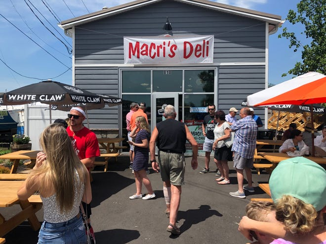 The new Macri's Deli was a busy place Saturday, as old and some new customers dropped by for the grand reopening at its new location at the Canandaigua City Pier.