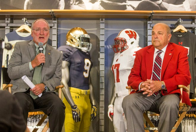 Notre Dame athletic director Jack Swarbrick and Wisconsin athletic director Barry Alvarez are shown on Aug. 14, 2017, during an announcement in Chicago for a series of football games in 2020 and 2021 to be played at Lambeau Field and Soldier Field. On Monday the canceled 2020 game was reset for 2026.