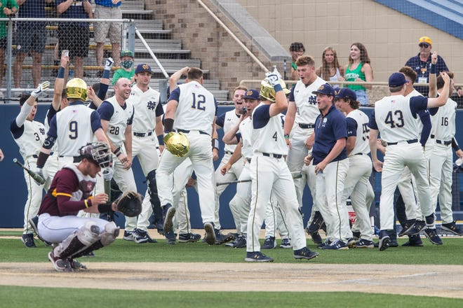 Notre Dame infielder Niko Kavadas (12) is congratulated by his teammates after hitting home run during a 14-2 victory over Central Michigan Sunday, June 6, 2021, at Frank Eck Stadium in South Bend. The Irish advance to the NCAA Super Regional round