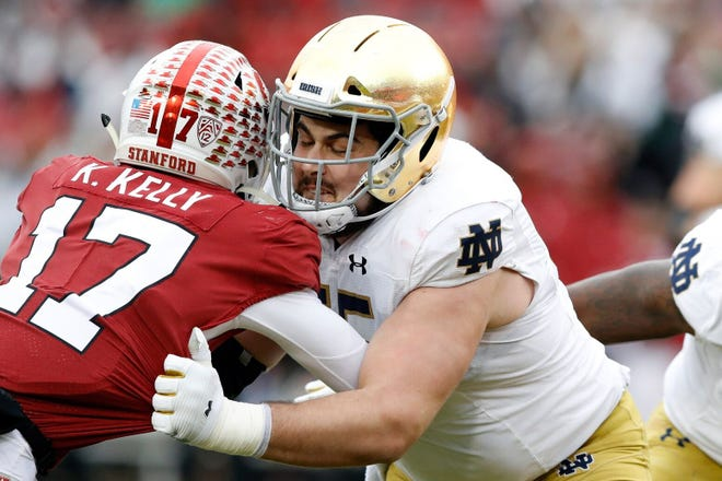 11/17/2020:  Center Jarrett Patterson, right, could end up playing tackle or guard for the Irish in 2021.