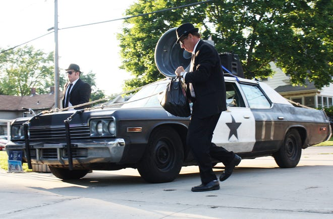 The Blooze Brothers arrive in style for its concert at Humiston-Riverside Park.