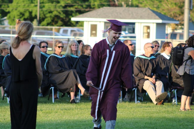 Landon Couture celebrates after receiving his diploma.