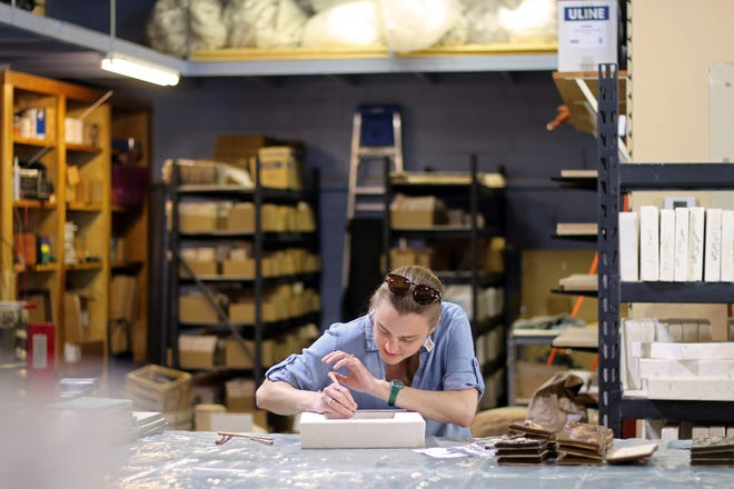 Cora Smith, owner of Little Traverse Tileworks, works on a tile in her new workspace and storefront in Harbor Springs.