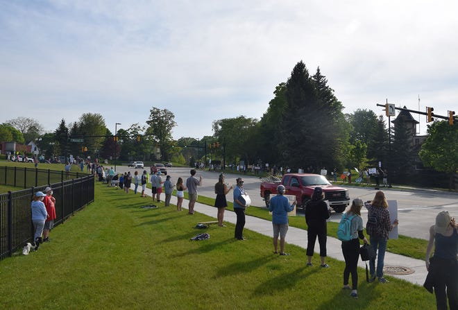 """This section of land in front of Petoskey's """"hole"""" has been both a popular protest spot, and a sore spot in negotiations between the 200 E. Lake St. developer and the city."""
