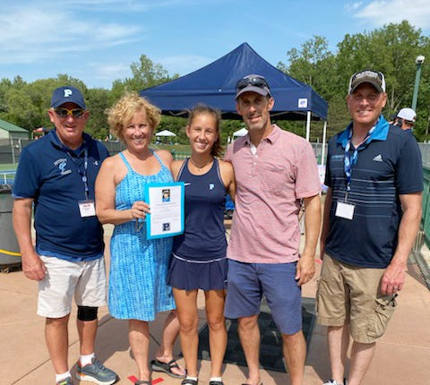 Petoskey senior Annabel Wilcox (middle) received the annual Dree Lo Memorial Scholarship recently from Petoskey coaches Denny Green (far left) and John Boyer (far right). She was joined by her parents, Joelle (left) and Dan (right) Wilcox.