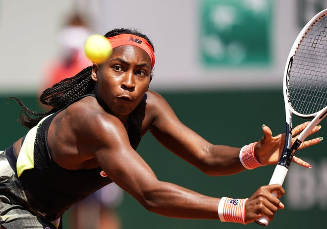 Coco Gauff gets ready for a return against Ons Jabeur during their fourth-round match Monday at the French Open in Paris.