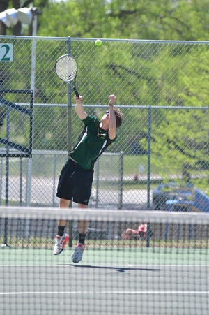 Pratt High School tennis player Rafe Donnenwerth reaches for a return during state tennis tournament action in May 2021.