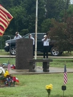 Volunteers participate in a gun salute for military veterans who gave their life for the freedom of the United States of America from their St. John community during 2021 Memorial Day Services at Fairview Cemetery.