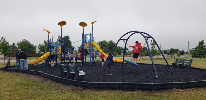 Just a few minutes after the ribbon-cutting ceremonies on May 31, kids were putting the new playground equipment to use.
