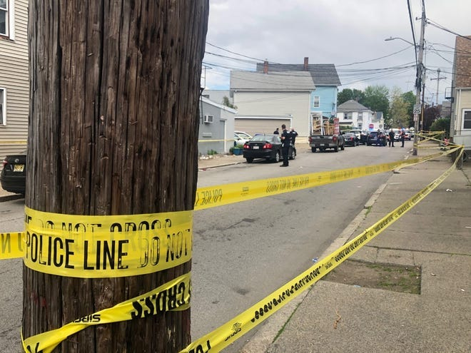 Pawtucket police investigate at the scene of the May 15 shooting.